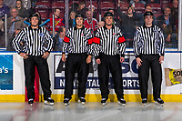 KELOWNA, BC - DECEMBER 18:  Linesman Dustin Minty, Referees Kevin Bennett and Steve Papp and linesman Tim Plamondon stand at the boards at the start of the game between Team Sweden and Team Russia at Prospera Place on December 18, 2018 in Kelowna, Canada. (Photo by Marissa Baecker/Getty Images)***Local Caption***