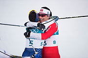 PYEONGCHANG-GUN, SOUTH KOREA - FEBRUARY 10: Marit Bjoergen of Norway gives Charlotte Kalla of Sweden a hug after the Ladies Cross Country Skiing 7.5km + 7.5km Skiathlon on day one of the PyeongChang 2018 Winter Olympic Games at Alpensia Cross-Country Centre on February 10, 2018 in Pyeongchang-gun, South Korea. Photo by Nils Petter Nilsson/Ombrello     <br /> ***BETALBILD***