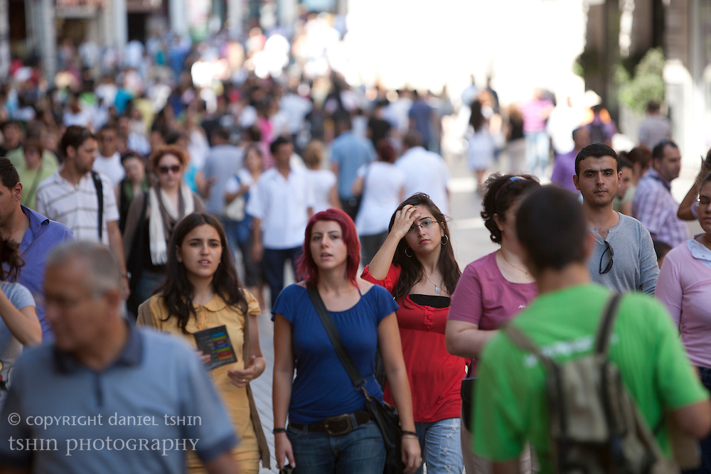 Pedestrians walking along ?stiklal Avenue, a walking street, in Beyo?lu on a summer afternoon.