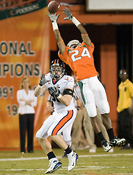 Miami (FL) defensive back Chavez Grant (24) tips a UVA pass.  Virginia tight end Tom Santi (86) made the reception.  The #19 Virginia Cavaliers defeated the Miami Hurricanes 48-0 at the Orange Bowl in Miami, Florida on November 10, 2007.  The game was the final game played in the Orange Bowl.