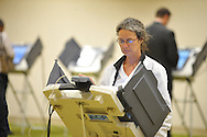 Andre Walker votes at the Oxford Conference Center in Oxford, Miss. on Tuesday, November 6, 2012. (AP Photo/Oxford Eagle, Bruce Newman)