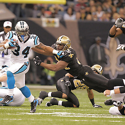 2008 December, 28: Carolina Panthers running back DeAngelo Williams (34) breaks the tackle by New Orleans Saints linebacker Jonathan Vilma (51) during a week 17 game between NFC South divisional rivals the Carolina Panthers and the New Orleans Saints at the Louisiana Superdome in New Orleans, LA.