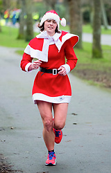 © London News Pictures. 25/12/2017. Aberystwyth, UK.  Members of the public dressed in festive costume take part a 5km run along Aberystwyth Park Avenue . Normally held on Saturday mornings, there were around 100 specially arranged extra Park Runs operating across the UK today. Photo credit: Keith Morris/LNP