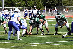 17 September 2011: Rob Gallik under center Nick Varchetto and protected by Alex Bell during an NCAA Division 3 football game between the Aurora Spartans and the Illinois Wesleyan Titans on Wilder Field inside Tucci Stadium in.Bloomington Illinois.
