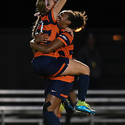 Cal State Fullerton player Sarah Fajnor jumps into the arms of teammate Atlanta Primus after scoring the first goal in their Big West Tournament semi final match against UC Irvine Thursday evening