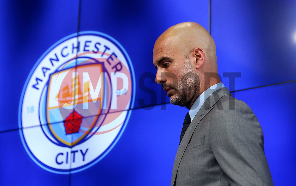 New Manchester City Manager Pep Guardiola takes his seat before speaking to the media during his first press conference - Mandatory by-line: Robbie Stephenson/JMP - 08/07/2016 - FOOTBALL - Manchester City Training Campus - Manchester, England - Pep Guardiola's debut press conference as manager of Manchester City