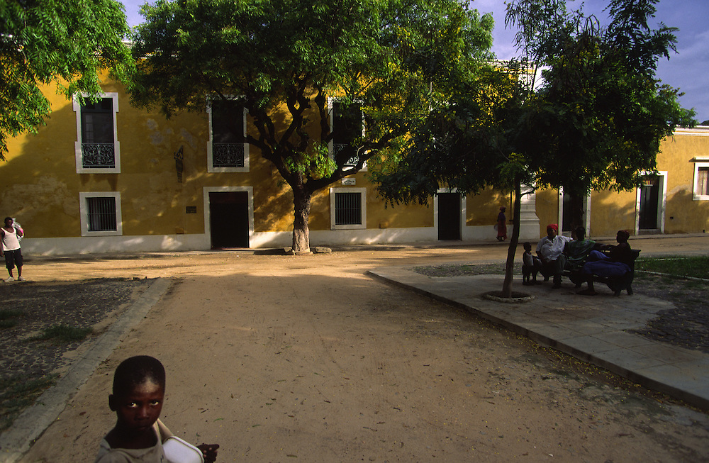 Some people gather at sunset in a square near Ilha de Mozambique Town Hall. Few are the builidings that have been recovered in this Unesco World Heritage Site