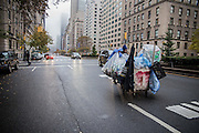 "17 November 2013 - New York, NY [Austin ""Guy"" Butler pushes his recycling cart up Park Avenue in Manhattan.] 11/17/13 Stoneham/CUNY Journalism Photo"