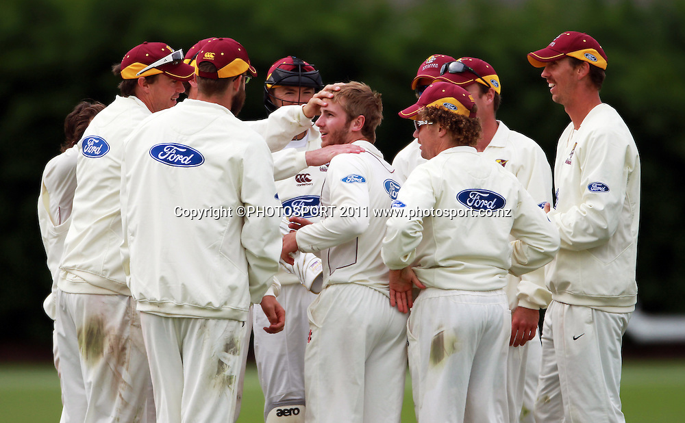 Northern players congratulate Kane Williamson after the wicket of James Franklin on day 3 of the 4 Day Plunket Shield cricket match between the Northern Knights and Wellington Firebirds. Played on Lincoln 2 in Lincoln, Canterbury. Wednesday 16 November 2011. Joseph Johnson/photosport.co.nz