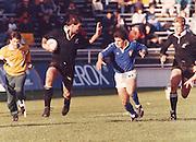 New Zealand vs Italy. Gary Whettom fuels past the Italian backed by John Kirwan. Date Unkown. Photo: Norman Smith