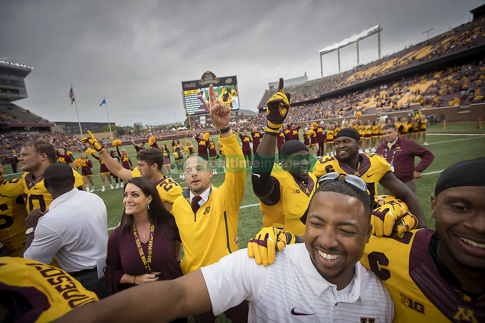 September 16, 2017 - Minneapolis, MN, USA - Minnesota head coach P.J. Fleck and celebrates with the team on the field after a 34-3 win against Middle Tennessee at TCF Bank Stadium, Saturday, Sept. 16, 2017, in Minneapolis. (Credit Image: © Elizabeth Flores/TNS via ZUMA Wire)