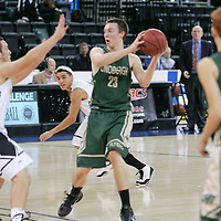 Senior Charley Mueller (23) looking for an open man underneath the Knights basket.