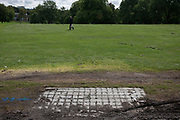 A park bench removed by unknown persons during the Sunfall festival in Lambeth's Brockwell Park, on 17th August 2017, in south London, England.