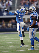 Detroit Lions middle linebacker Tahir Whitehead (59) celebrates after a second quarter quarterback sack during the NFL week 18 NFC Wild Card postseason football game against the Dallas Cowboys on Sunday, Jan. 4, 2015 in Arlington, Texas. The Cowboys won the game 24-20. ©Paul Anthony Spinelli