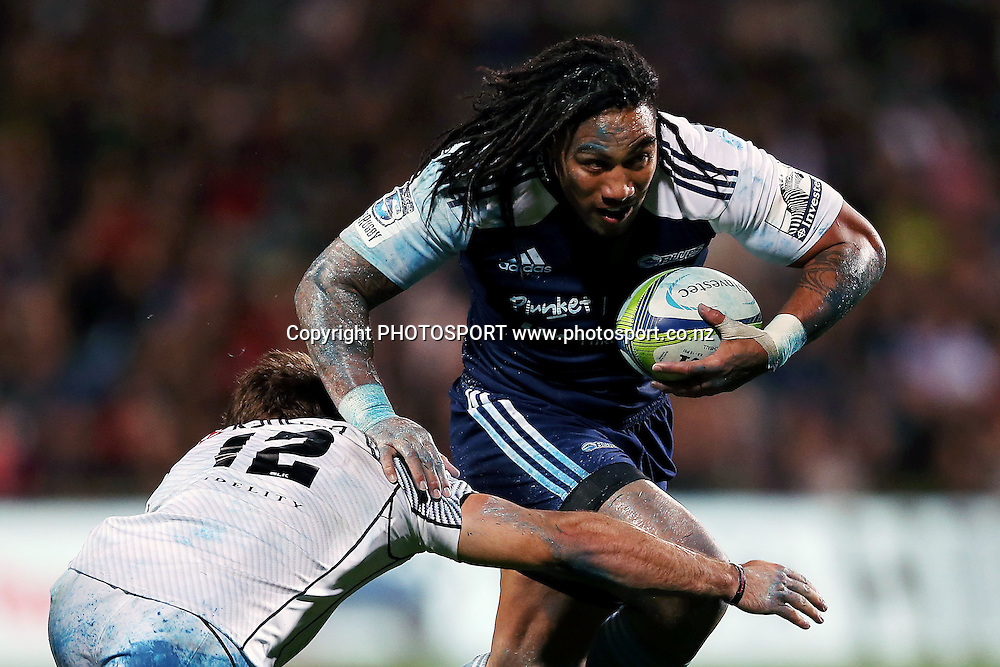 Ma'a Nonu of the Blues is tackled by Paul Jordaan of the Sharks. Super Rugby rugby union match, Blues v Sharks at North Harbour Stadium, Auckland, New Zealand. Friday 23rd May 2014. Photo: Anthony Au-Yeung / photosport.co.nz