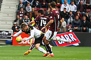 Blazej Augustyn fouls David Goodwille  during the Ladbrokes Scottish Premiership match between Heart of Midlothian and Aberdeen at Tynecastle Stadium, Gorgie, Scotland on 20 September 2015. Photo by Craig McAllister.