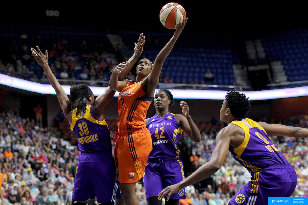 UNCASVILLE, CONNECTICUT- JULY 15:   Camille Little #2 of the Connecticut Sun shoots past Nneka Ogwumike #30 of the Los Angeles Sparks during the Los Angeles Sparks Vs Connecticut Sun, WNBA regular season game at Mohegan Sun Arena on July 15, 2016 in Uncasville, Connecticut. (Photo by Tim Clayton/Corbis via Getty Images)