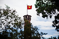 The Cot Co  watchtower with the Vietnamese flag flying above it, in Hanoi, Vietnam.
