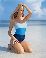 Torrey is showing of her starless swimsuit on a sandbar in the waters of Key West - shot for the annual swimsuit issue of the Boston Proper fashion catalog.