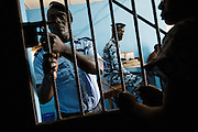 Photo illustration showing a woman being locked up into a cell at the police station in Katiola, Cote d'Ivoire on Saturday July 13, 2013. In July 2012,  for the first time ever in the country, nine women were arrested and jailed for performing genital mutilation on girls.