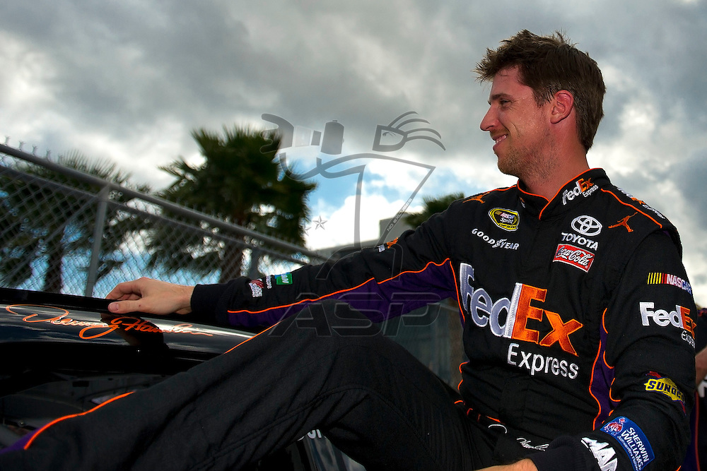 Daytona Beach, FL - FEB 19, 2012: Denny Hamlin (11) gets out of the car during qualifying for the Daytona 500 at the Daytona International Speedway in Daytona Beach, FL.