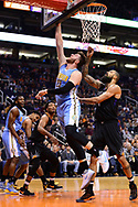 Jan 28, 2017; Phoenix, AZ, USA; Denver Nuggets center Jusuf Nurkic (23) lays up the ball in front of Phoenix Suns center Tyson Chandler (4) in the first half of the NBA game at Talking Stick Resort Arena. Mandatory Credit: Jennifer Stewart-USA TODAY Sports