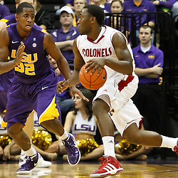 November 12, 2011; Baton Rouge, LA; Nicholls State Colonels guard Dantrell Thomas (1) drives past LSU Tigers guard John Isaac (32) during the first half of a game at the Pete Maravich Assembly Center.  Mandatory Credit: Derick E. Hingle-US PRESSWIRE