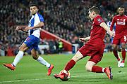 Liverpool midfielder James Milner (7) turns FC Porto forward Jesus Manuel Corona (17) during the Champions League Quarter-Final Leg 1 of 2 match between Liverpool and FC Porto at Anfield, Liverpool, England on 9 April 2019.
