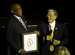 """Former San Francisco Mayor Willie Brown presents the Asian Pacific American Heritage Award for Lifetime Impact to Norman Mineta, at the CAAM Film Festival's world premiere of """"An American Story: Norman Mineta and His Legacy"""" at the Castro Theatre, Thursday, May 10, 2018 in San Francisco, Calif. (D. Ross Cameron/SF Chronicle)"""