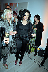 Left to right, LIZ BREWER and NANCY DELL'OLIO at the presentation of the Veuve Clicquot Business Woman Award 2009 hosted by Graham Boyes MD Moet Hennessy UK and presented by Sir Trevor Macdonald at The Saatchi Gallery, Duke of York's Square, Kings Road, London SW1 on 28th April 2009.