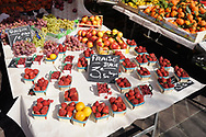 Strawberries and other soft fruit for sale in a french market