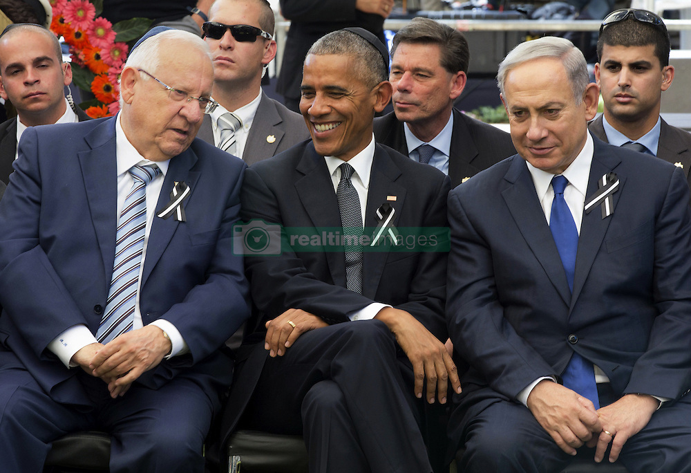 September 30, 2016 - Jerusalem, Israel - Israeli President Reuven Rivlin, left, sits with U.S President Barack Obama and Israeli Prime Minister Benjamin Netanyahu during the funeral of Israeli President Shimon Peres at Mt. Herzl Cemetery September 30, 2016 in Jerusalem, Israel. Peres passed away on September 28th at the age of 93 and was the last of the founding fathers of modern Israel. (Credit Image: © Presidenciamx/Planet Pix via ZUMA Wire)