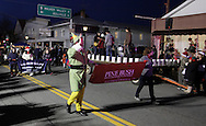 Pine Bush, New York  - People marching in the parade head down Main Street during A Community Country Christmas 2011 on Dec. 3, 2011. The celebration was presented by the Pine Bush Area Chamber of Commerce.