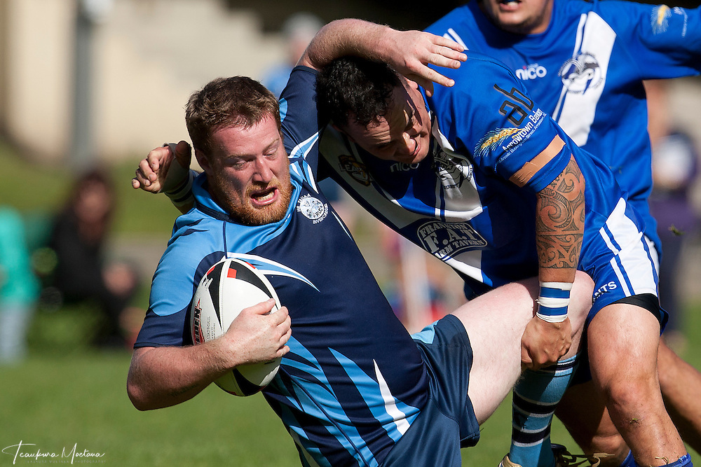 Sam Mullins (L) of He Tauaa is tackled by Darren Reire (R) of the Wakatipu Giants during the round one Southland District Rugby league match between the Wakatipu Giants and He Tauaa at Queenstown Recreation Ground, Queenstown, New Zealand, Sunday April 01, 2012. Credit:Teaukura Moetaua / Media Sport