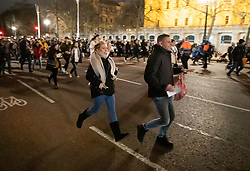 © Licensed to London News Pictures. 31/12/2018. London, UK. People rush to go through a security check on The Mall as they arrive to celebrate New Year's Eve in central London.  Over 100,000 people are attending London's ticketed fireworks display on the banks of the River Thames for New Year's Eve tonight. Photo credit: Peter Macdiarmid/LNP