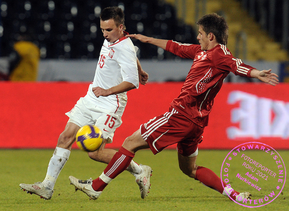 (L) SLAWOMIR PESZKO (POLAND) & (R) MIKE KLUKOWSKI (CANADA) FIGHT FOR THE BALL DURING FRIENDLY SOCCER MATCH BETWEEN POLAND AND CANADA IN BYDGOSZCZ , POLAND...POLAND , BYDGOSZCZ , NOVEMBER 18, 2009..( PHOTO BY ADAM NURKIEWICZ / MEDIASPORT )..PICTURE ALSO AVAIBLE IN RAW OR TIFF FORMAT ON SPECIAL REQUEST.