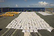Navy seizes a TONNE of heroin worth £160million hidden inside sacks of cement on a tiny sailing boat in the Indian Ocean<br /> <br /> A tonne of heroin worth almost £160million has been found hidden inside sacks of cement on a tiny sailing boat in the Indian Ocean.<br /> <br /> The crew of an Australian warship intercepted the dhow 27 nautical miles east of the Kenyan port city of Mombasa and discovered the drugs stowed in 46 separate bags.<br /> <br /> The seizure is largest ever in the history of the Combined Maritime Forces, a joint operation between 30 countries to combat piracy, militancy and smuggling in the waters east of Africa.<br /> <br /> The frigate HMAS Darwin intercepted the vessel on Wednesday night and confiscated 1,023 kg  of heroin, according to Australia's Defence Department.<br /> <br /> The drugs were destroyed, the online statement said.<br /> <br /> 'This is a major heroin seizure, which has removed a major source of funding from terrorist criminal networks,' said the ship's commanding officer Commander Terry Morrison.<br /> <br /> The coup came as part of the joint operation's bid to preserve order in a huge region spanning the Red Sea, Gulf of Aden, Arabian Gulf, Arabian Sea, Indian Ocean and the Gulf of Oman.<br /> <br /> The area includes the waters off Somalia's Horn of Africa, which have been blighted by piracy including several high-profile hijackings of British yachts.<br /> <br /> Kenyan defence spokesman Bogita Ongeri told Nigeria's Saturday Nation that the haul was not seized within Kenya's territorial waters.<br /> <br /> 'I can authoritatively say that the seizure of such heroin never happened within our Exclusive Economic Zone,' he said.<br /> <br /> 'We are doing daily surveillance within our territorial waters and we have not received such a report.'<br /> <br /> News agencies described the vessel as a dhow, a traditional African and Middle Eastern sailing boat, although no sails were erected when it was photographed by the Australian Navy.<br /> <br /> There has been a surge in the volumes of heroin trafficked through eastern Africa in the past few years, according to the Uni