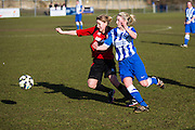 Kirstie Barton battles during the FA Women's Sussex Challenge Cup semi-final match between Brighton Ladies and Hassocks Ladies FC at Culver Road, Lancing, United Kingdom on 15 February 2015. Photo by Geoff Penn.