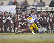 Picayune's Preston Dedeaux (33) vs. Oxford High's Mark Pegues (24) in the MHSAA Class 5A championship game at Mississippi Veterans Memorial Stadium in Jackson, Miss. on Saturday, December 7, 2013. Picayune rallied to win 42-35.