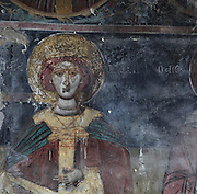 Fresco of a saint in the Dormition of Saint Mary Cathedral Church, or Kisha Katedrale Fjetja e Shen Marise, built 1699, Voskopoje, Korce, Albania. The church contains frescoes by Theodor Anagnost and Sterian from Agrapha in Greece, and the large icons in the iconostasis were painted 1703 by Constantine Lemoronachos. Picture by Manuel Cohen