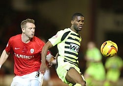 Yeovil Town's Joel Grant and Barnsley's Peter Ramage battle for the ball - Photo mandatory by-line: Matt Bunn/JMP - Tel: Mobile: 07966 386802 14/12/2013 - SPORT - Football - Barnsley - Oakwell - Barnsley v Yeovil Town - Sky Bet Championship