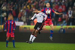 BUCHAREST, ROMANIA - Thursday, December 2, 2010: Liverpool's Ryan Babel and FC Steaua Bucuresti's Stanislav Angelov during the UEFA Europa League Group K match at the Stadionul Steaua. (Pic by: David Rawcliffe/Propaganda)