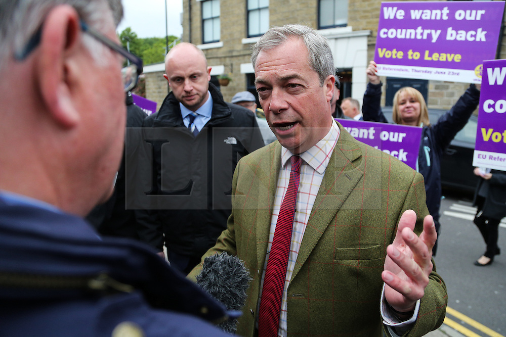 © Licensed to London News Pictures. 25/05/2016. Chapeltown, UK. Nigel Farage meets the public in Chapeltown, South Yorkshire, during the UKIP Referendum open top bus in tour. The party's purple open top battle bus is touring the country in the run up to the EU referendum. There is just a month to go until the UK's referendum on it's membership of the European Union. Poll stations will open their doors on Thursday 23 June. Photo credit : Ian Hinchliffe/LNP