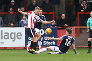 Kyle Storer and Glen Rea during the EFL Sky Bet League 2 match between Cheltenham Town and Luton Town at Whaddon Road, Cheltenham, England on 11 November 2017. Photo by Antony Thompson.