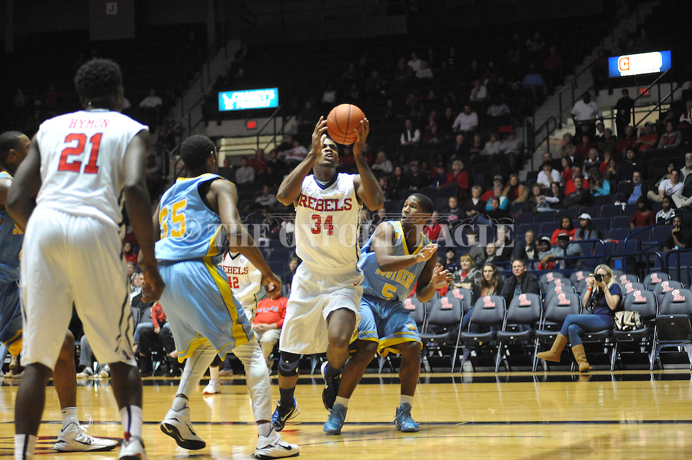 "Ole Miss' forward Aaron Jones (34) is fouled by southern University Jaguars guard Michael Harrel (5) at the C.M. ""Tad"" Smith Coliseum in Oxford, Miss. on Thursday, November 20, 2014. (AP Photo/Oxford Eagle, Bruce Newman)"