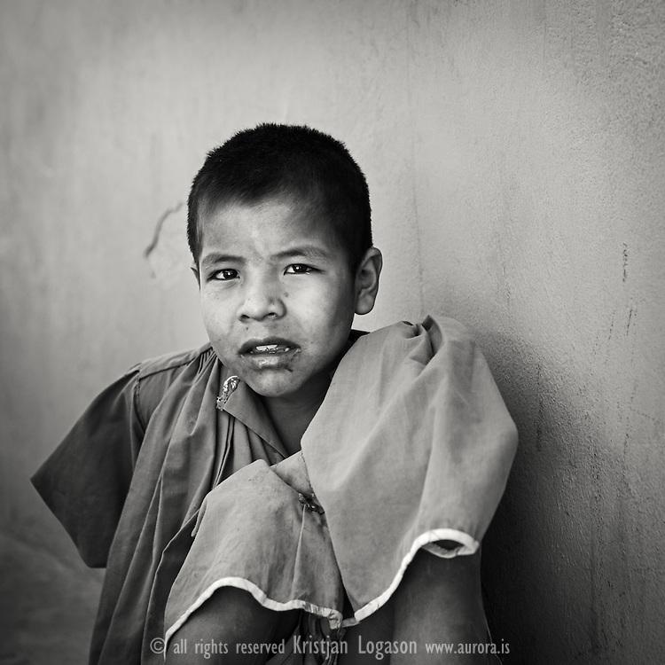 Young Tarahumara boy in Munearachi looks curious towards the camera