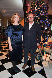 FERGUS & MARGO HENDERSON at the unveiling of the Claridge's Christmas tree 2011 designed by Alber Elbaz for Lanvin held at Claridge's, Brook Street, London on 5th December 2011.