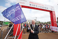 {Prudential RideLondon-Surrey Classic. David Munro the offical starter of the race.}<br /> Prudential RideLondon, the world's greatest festival of cycling, involving 70,000+ cyclists – from Olympic champions to a free family fun ride - riding in five events over closed roads in London and Surrey over the weekend of 9th and 10th August. <br /> <br /> Photo: Roger Allen for Prudential RideLondon<br /> <br /> See www.PrudentialRideLondon.co.uk for more.<br /> <br /> For further information: Penny Dain 07799 170433<br /> pennyd@ridelondon.co.uk