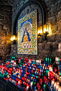 Votive candles to an icon of Santa Maria de Montserrat Abbey, Monistrol de Montserrat,  Catalonia, Spain.