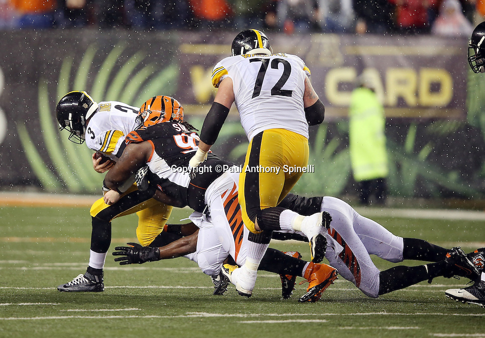 Pittsburgh Steelers center Cody Wallace (72) looks on as Pittsburgh Steelers quarterback Landry Jones (3) gets sacked in the fourth quarter by Cincinnati Bengals defensive tackle Pat Sims (92) and a Bengals teammate during the NFL AFC Wild Card playoff football game against the Cincinnati Bengals on Saturday, Jan. 9, 2016 in Cincinnati. The Steelers won the game 18-16. (©Paul Anthony Spinelli)